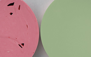 Compare the surfaces of Express™ XT Penta™ Putty (right) and a common hand-mix putty material